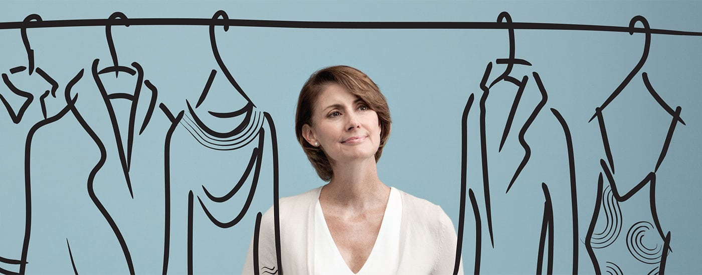 Photo illustration of a woman choosing clothes from a closet