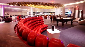 Image of Virgin Atlantic lounge in New York's JFK Airport with red couch in the foreground