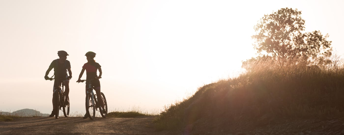Two people riding mountain bikes Health Savings Accounts HSA benefits