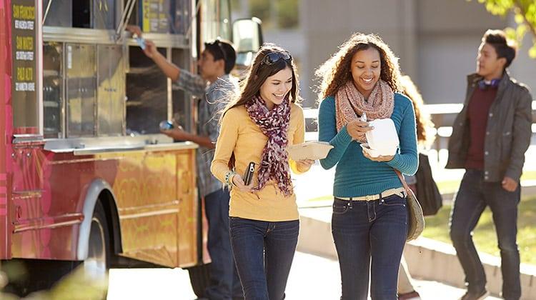 teenage friends buying food