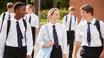 children wearing private school uniforms