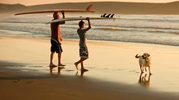 family surfing together