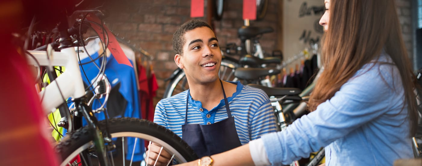 teenager working in bicycle shop