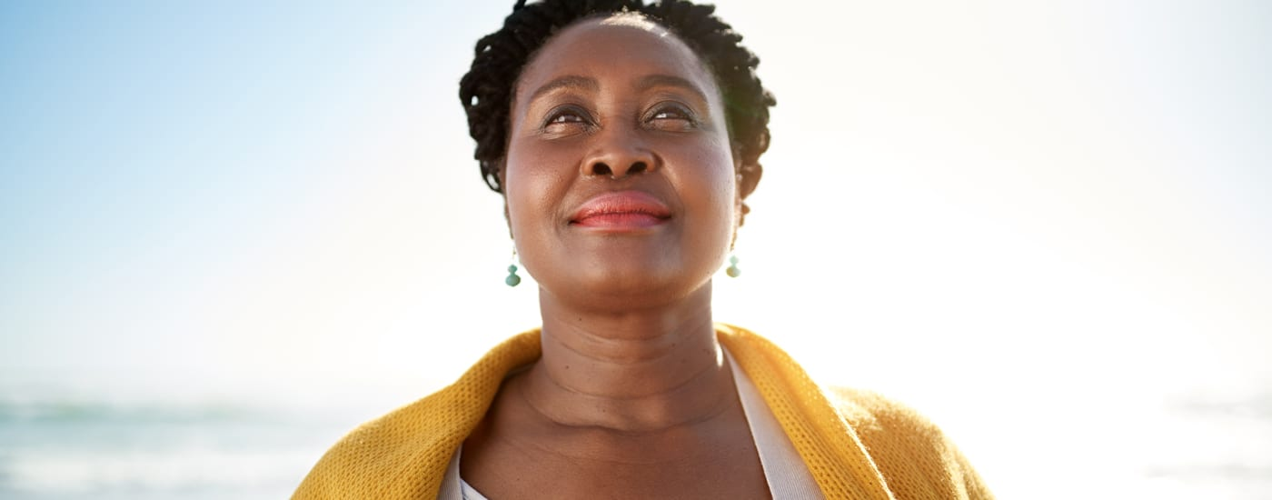 a confident woman looks ahead to retirement