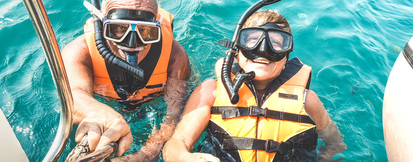 A couple goes snorkeling.