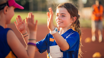 A girl celebrates after winning a track meet. Encouraging their passions for sports and other hobbies can help create a well-rounded child.