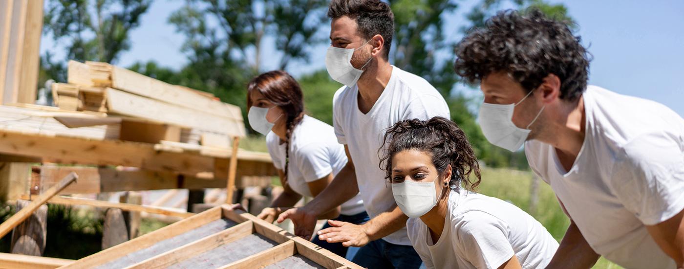 Volunteers help build a house.