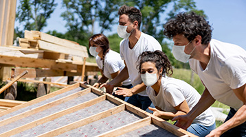 Volunteers help build a house.