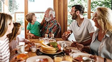 A family talks around the kitchen table.