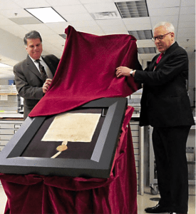 Photo of David M. Rubenstein unveiling the Magna Carta.